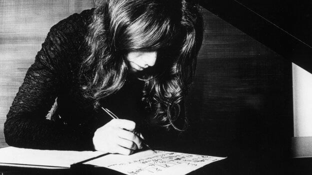 Carole King, composing.