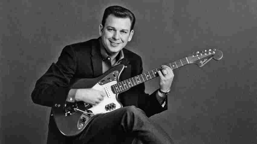 Billy Strange poses for a portrait with a Fender sometime in the 1960s.