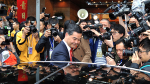 The other top candidate for chief executive, Leung Chun-ying (center, shown here Feb. 23), is also under scrutiny, for an alleged conflict of interest while judging a design contest for an arts complex — in which he allegedly voted for a company linked to his own.