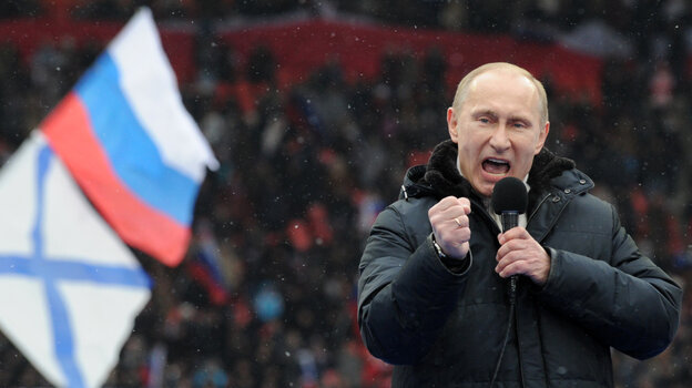 Prime Minister Vladimir Putin delivers a campaign speech during a rally of his supporters in Moscow, Feb. 23. Putin is mounting a vigorous campaign in the face of growing opposition but is e