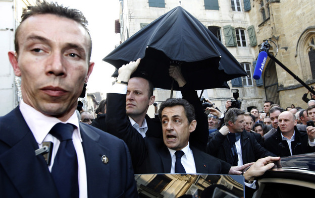 French President Nicolas Sarkozy (center) was surrounded by security staff after a crowd in the Basque city of Bayonne became unruly Thursday.