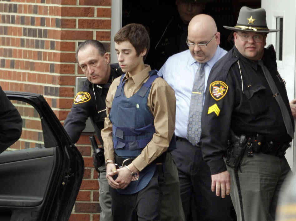 In this Tuesday, Feb. 28, 2012 photo, seventeen-year-old T.J. Lane is led from Juvenile Court by Sheriff's deputies in C