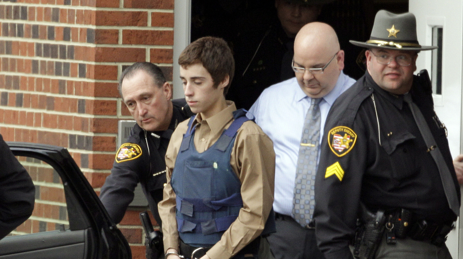 In this Tuesday, Feb. 28, 2012 photo, seventeen-year-old T.J. Lane is led from Juvenile Court by Sheriff's deputies in Chardon, Ohio. (AP)