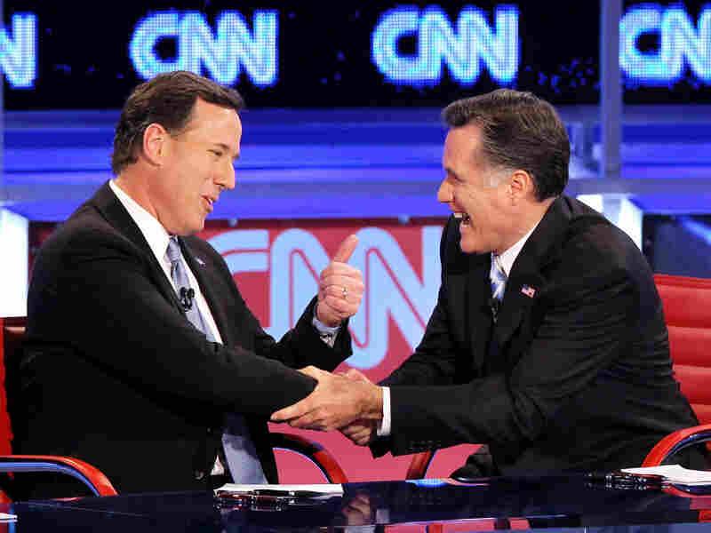 Republican presidential candidates Rick Santorum and  Mitt Romney talk after participating in a debate at the Mesa Arts Center Feb. 22, 2012 in Mesa, Arizona. The candidates are often at odds over what are their primary goals for the election.