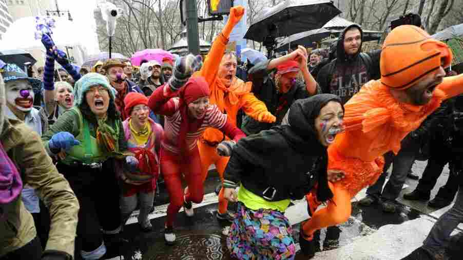 """Occupy Wall Street protesters shout during a """"Shut Down the Corporations"""" demonstration in New York on Wednesday."""