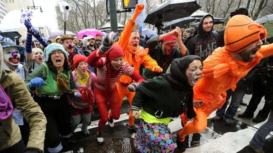 """Occupy Wall Street protesters shout during a """"Shut Down the Corporations"""" demonstration in New York on Wednesday. (Timothy A. Clary/AFP/Getty Images)"""