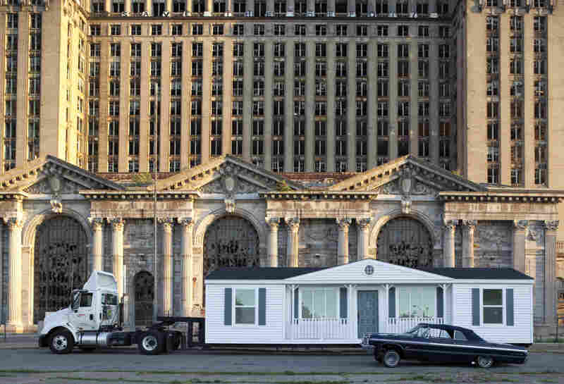 Mike Kelley built a replica of his childhood home and repositioned it around Detriot. Three of his videos are on display at the Whitney. Above The Mobile Homestead is pictured in front of the abandoned Detroit Central Train Station. Kelley died in January.