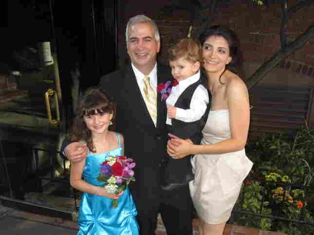 Shadid stands with wife Nada, son Malik and daughter Laila at his brother's wedding last summer.