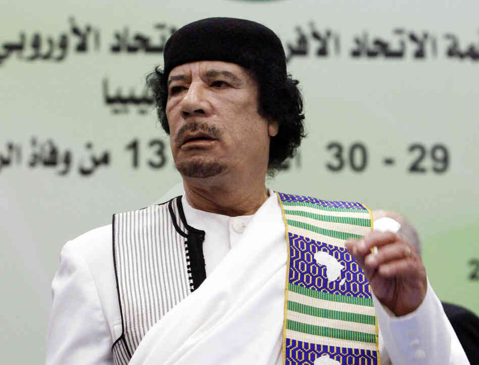 The late Moammar Gadhafi attends the opening session of the Africa-EU summi
