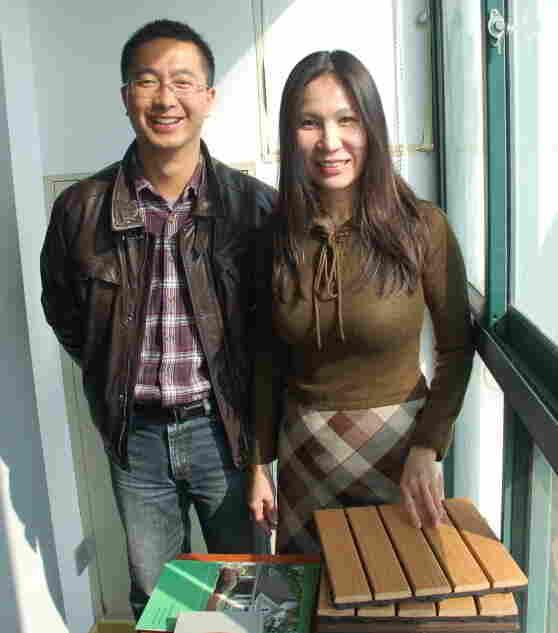 Jacky Jiang and Rosalia Yang, with imitation-wood flooring.