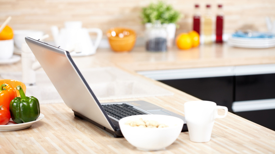 The laptop is replacing the recipe box in many American kitchens. (iStockphoto.com)