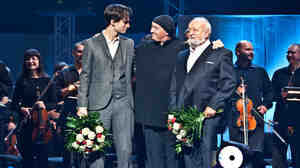 Jonny Greenwood, AUKSO Chamber Orchestra conductor Marek Mos and Krzysztof Penderecki, on stage after a 2011 concert.