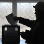 There were widespread allegations of fraud in Russia's parliamentary polls in December. In advance of Russia's presidential election Sunday, Russian citizens abroad have been allowed to vote early. This woman casts a ballot in Kyrgyzstan on Feb. 26.