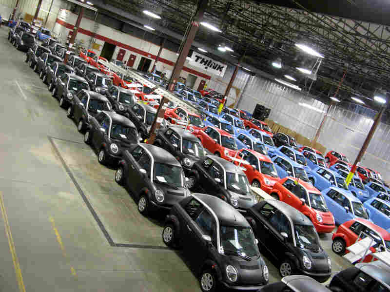 Most of these electric cars on the Think factory floor in Elkhart, Ind., are finished and ready to go, waiting to be sold. Some are merely waiting