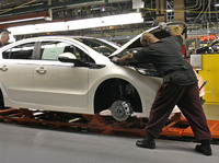 Workers assemble a Chevrolet Volt at GM's Detroit Hamtramck Assembly Plant in October. The auto maker says it will idle the plant for five weeks, to allow demand to catch up with inventory.