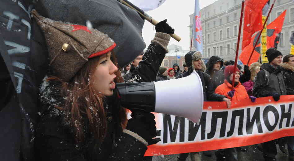 Russian demonstrators protest in St. Petersburg against Prime Minister Vladimir Putin's expected return to the Kremlin.