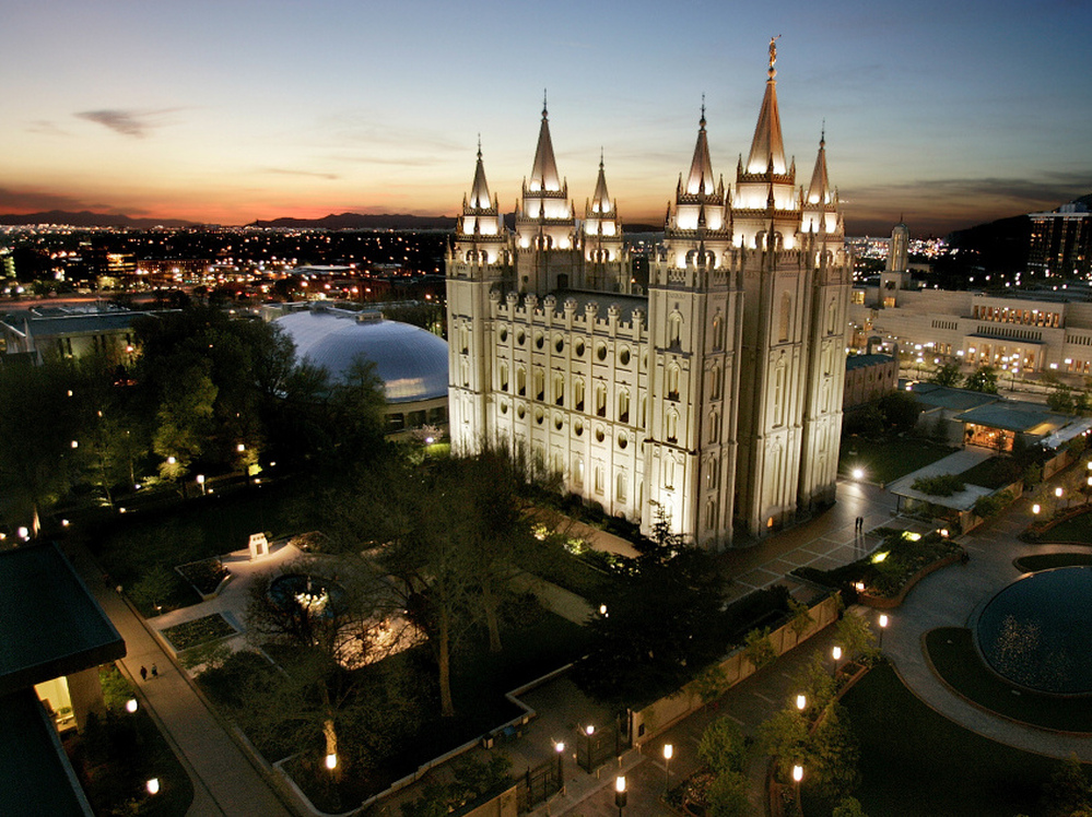 The sun sets behind the Mormon Temple, the centerpiece of Temple Square, in Salt Lake City.