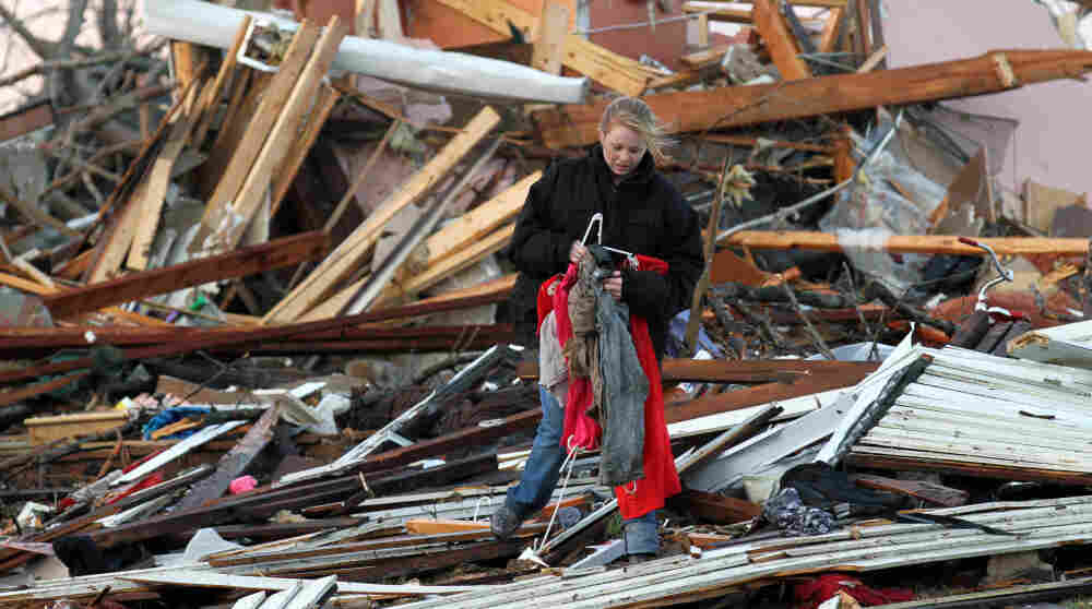 A woman salvages belongings from her Henryville, Ind., home, which was destroyed Friday after a series of tornadoes tore through the south of the state.