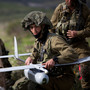 Israeli soldiers get ready to launch the Skylark drone during a drill in January. Israelis are required to serve in the military, and an exemptions for ultra-Orthodox Jews has created a fierce debate.