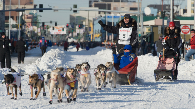 Iditarod musher Allen Moore and his team make their way through downtown Anchorage in the ceremonial start of the Iditarod Trail Sled Dog Race on Saturday. The actual race began on Sunday.