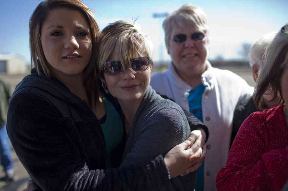 Nikki Lopez, 16, and her mother, Robin Robertson, wait outside of the Potter County Detention Center on March 2 in Amarillo, Texas. Nikki's father, Ernie Lopez, was released moments later.