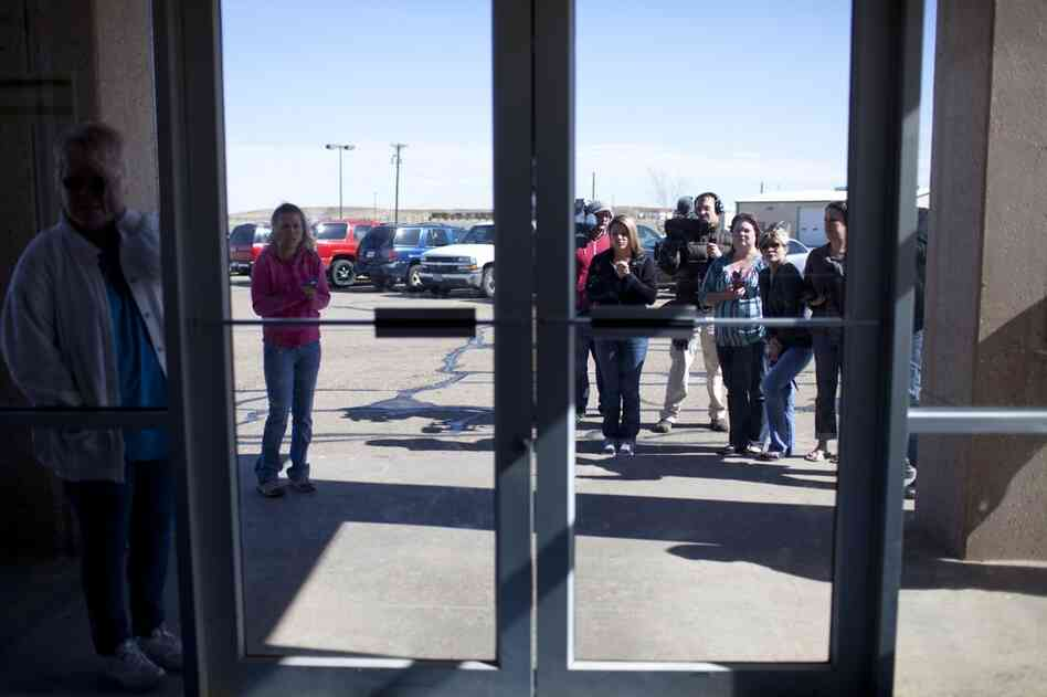 Supporters and family members of Ernie Lopez wait outside the Potter County Detention Center in Amarillo, Texas.