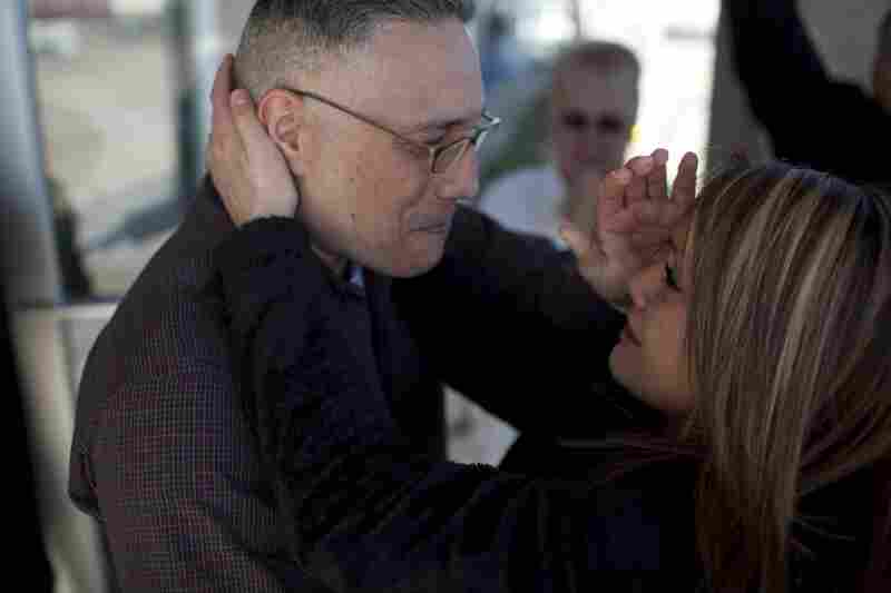 Ernie Lopez hugs his daughter, Nikki, for the first time since 2009. Ernie was released from prison on March 2.