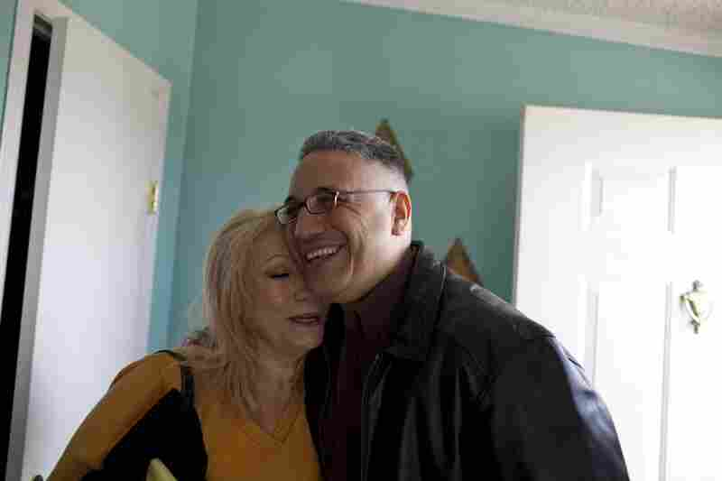 Ernie Lopez hugs his mother, Rosie Lopez, after entering the family home for the first time since his conviction in 2003.