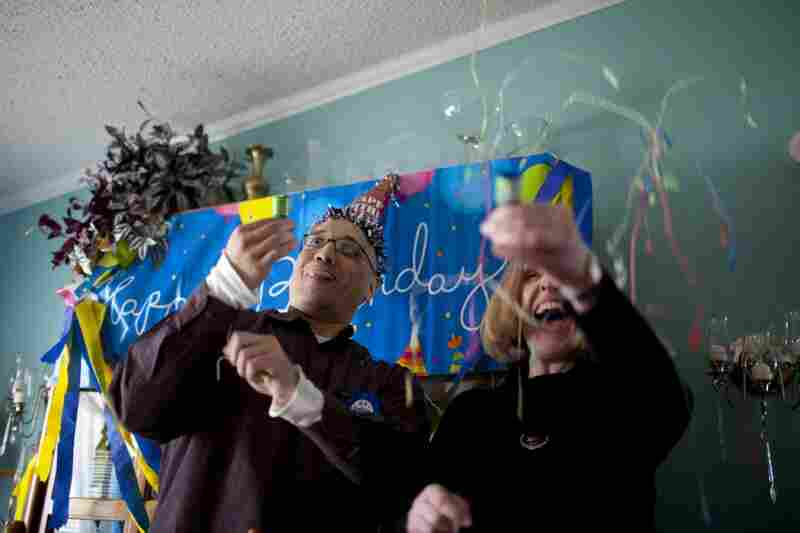 Lopez and his attorney, Heather Kirkwood, celebrate one of his many missed birthdays during his release party at his family's home.