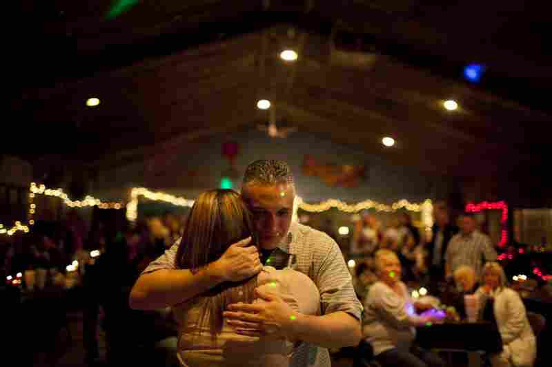 Lopez dances with his daughter, Nikki, for the first time in his life during the fundraiser in Amarillo.
