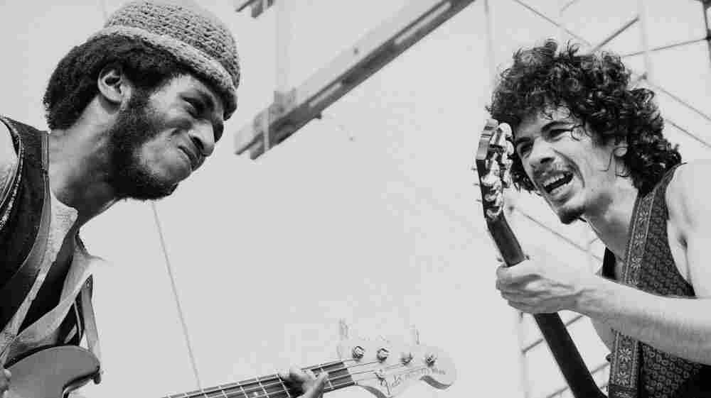 Carlos Santana with bassist David Brown performing at Woodstock.