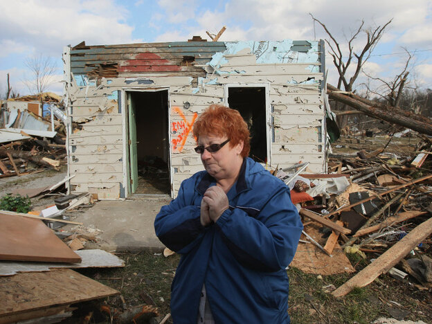 In Henryville, Ind., on Sunday, Janet Clark stood outside what remains of her home, which was destroyed in Friday's tornado.