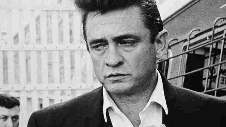 Johnny Cash walks inside the gates of Folsom Prison, preparing to perform his fourth concert for inmates there.