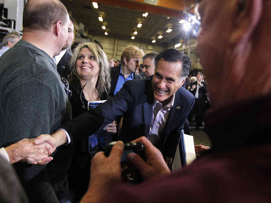 Mitt Romney greets supporters in