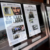 A new study suggests ways newspapers can survive in the digital world. Here dead-tree versions of front pages from around the country announce the death of Osama bin Laden  in front of the Newseum in Washington on May 2, 2011.
