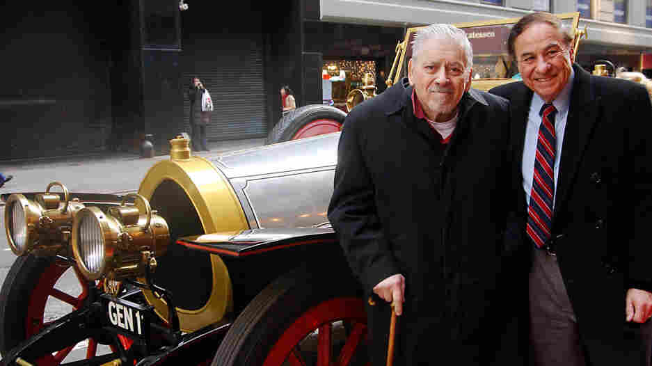 Composer/lyricist Robert Sherman (left) and his brother Richard stand next to the car used in the 1968 film Chitty Chitty Bang Bang. The brothers wrote the songs for the movie, as well as a musical version that began running in 2002.