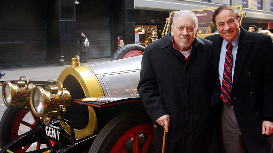 Composer/lyricist Robert Sherman (left) and his brother Richard stand next to the car used in the 1968 film <em>Chitty Chitty Bang Bang</em>. The brothers wrote the songs for the movie, as well as a musical version that began running in 2002.