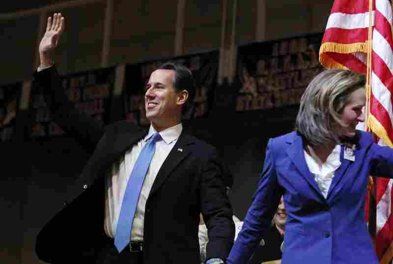 Rick Santorum and his wife, Karen, arrive at a rally in Steubenville, Ohio.
