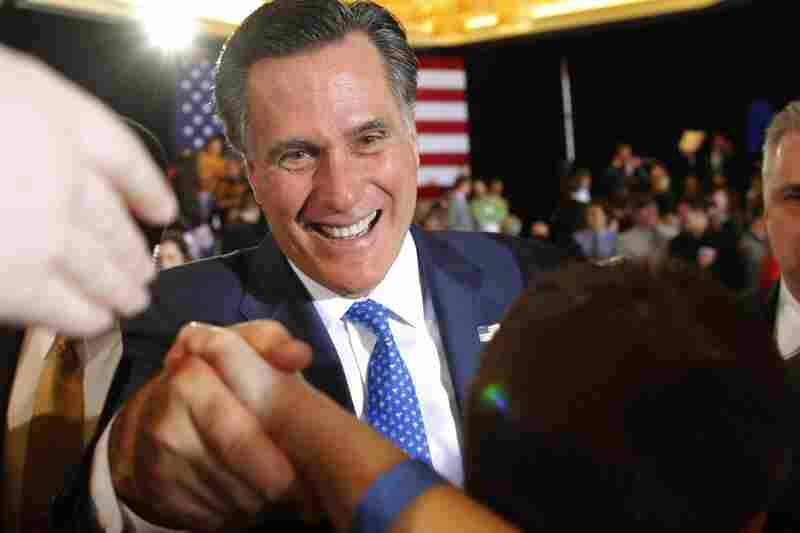 Mitt Romney shakes hands with supporters at his primary election night rally in Boston. Romney won the race in Massachusetts.