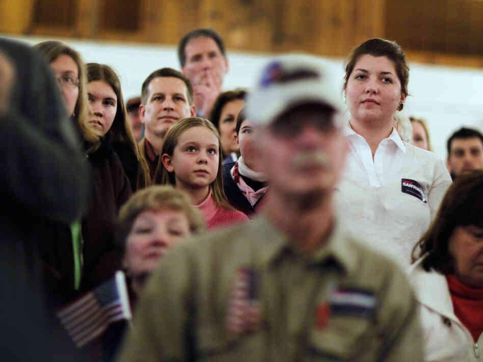 People listen as Republican presidential candidate and Rick Santorum speaks during a campaign rally at an American Legion on March 5, 2012 in Westerville, Ohio. Voters go to the polls for on Super Tuesday primary day, as the Republican Party continues the process of deciding who their general election candidate will be.