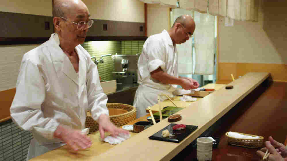 Jiro Ono (left) owns and runs a celebrated