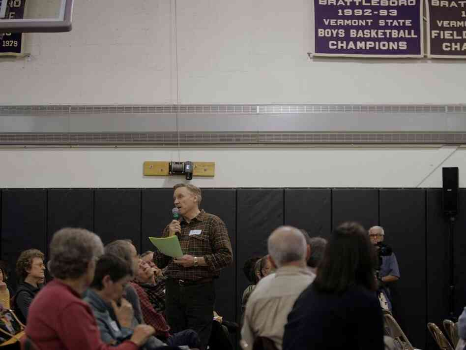 Steve Carlton speaks during a debate to vote on a resolution calling for the possible impeachment of U.S. President George W. Bush March 25, 2006 at a town meeting in Brattleboro, Vermont. Vermont's town meetings are one example American democracy.