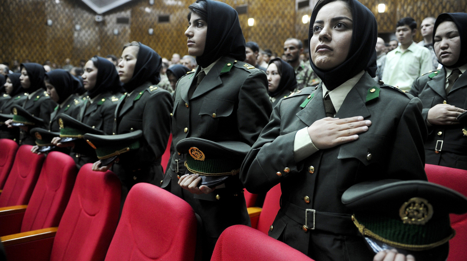 Afghan female cadets attend their graduation ceremony at the Military Training Center in Kabul, the Afghan capital, May 19. Some women say they joined the security forces in order to serve their country, but many say it's because the pay is better than working as a maid or teacher. (AFP/Getty Images)