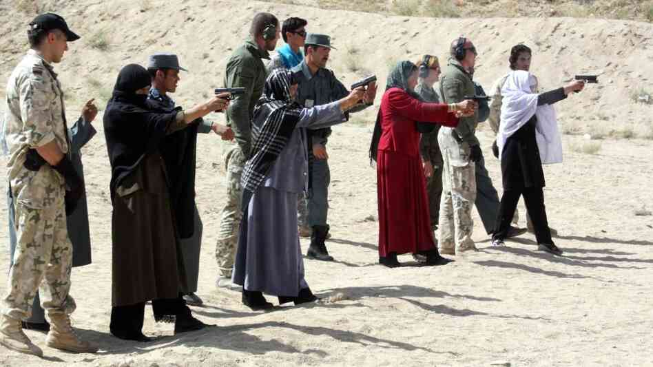 Afghan female police officers are trained by Afghan police and NATO soldiers in eastern Afghanistan's Ghazni province on Sept. 12. In the cul