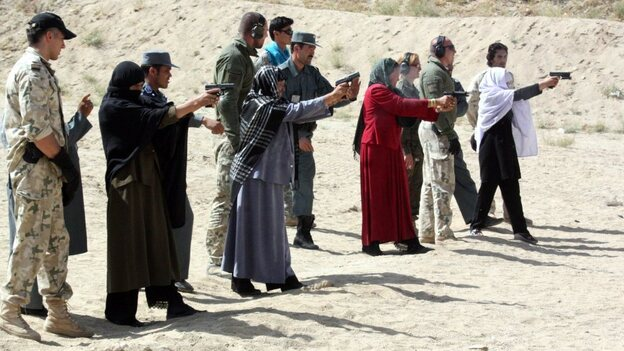 Afghan female police officers are trained by Afghan police and NATO soldiers in eastern Afghanistan's Ghazni province on Sept. 12. In the culturally conservative country, women serving in the security forces say they face systemic sexual coercion and even rape by male colleagues. (EPA/Landov)