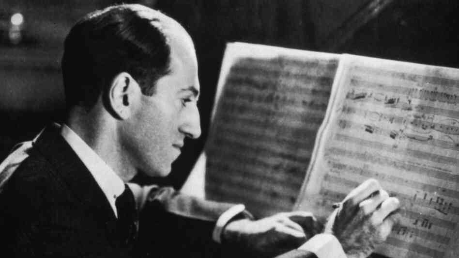 George Gershwin making alterations to the score for 'Porgy and Bess'.