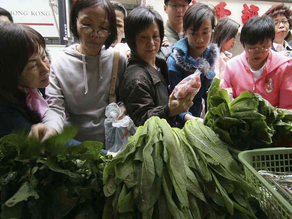 Consumers rush to buy organic products from a farmers market in Hong Kong.