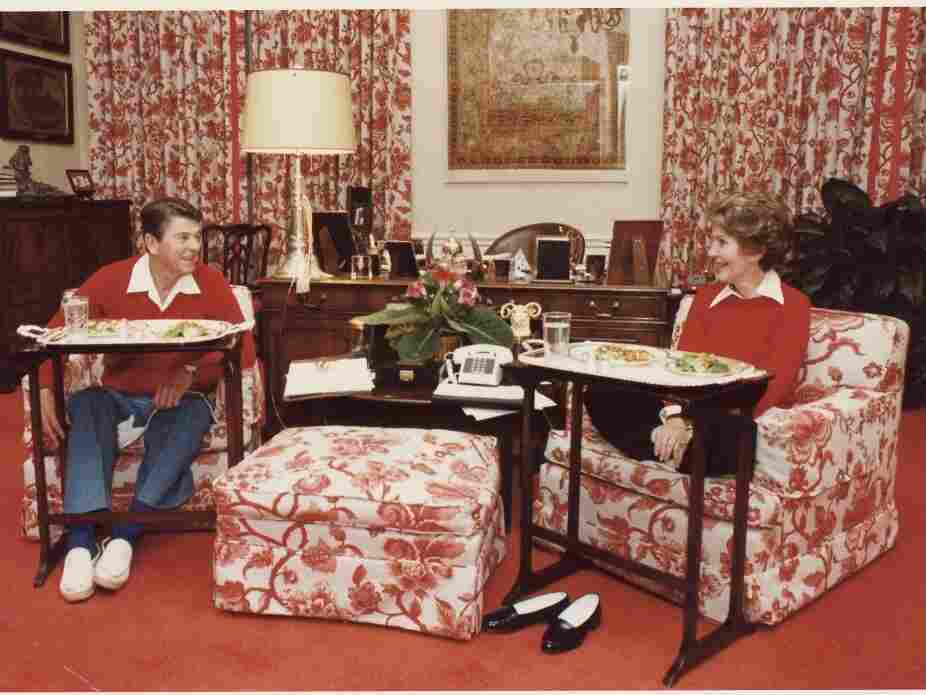 President Ronald Reagan and first lady Nancy Reagan dine on TV trays in the White House residence, Nov. 6, 1981.