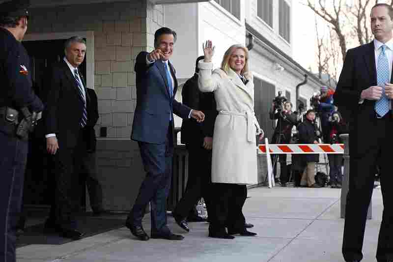 Romney and his wife, Ann, wave to supporters after voting in the Massachusetts primary in Belmont, Mass.