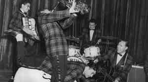 Bill Haley and the Comets rehearsing at the Dominion Theatre for their first British show.